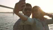 Young couple in love taking selfie together after wonderful day on beach Stock Footage