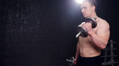 Strong bodybuilder with six pack, perfect abs, shoulders, biceps, triceps and Stock Footage