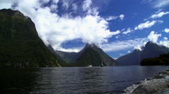 Scenic landscape of Milford Sound Piopiotahi Fjord with Mitre Peak mountain Stock Footage