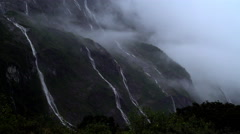 Landscape photography of mountain Waterfall in Milford Sound Piopiotahi UNESCO Stock Footage