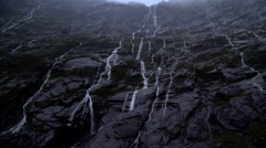 Landscape photography of mountain waterfalls in valley of Milford Sound Stock Footage