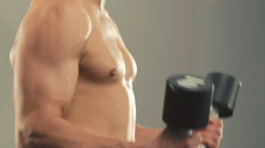 Profile of bodybuilder training with the loads for arms muscles in gym Stock Footage