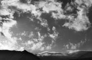 Black and white sky with clouds and mountains in evening Stock Photos