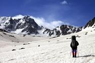 Hiker on snow plateau at spring mountain. Stock Photos
