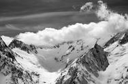 Black and white winter mountains in clouds Stock Photos