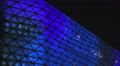 Shopping and entertainment center, beautiful blue illumination on glass exterior HD Footage