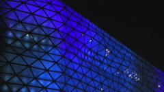 Shopping and entertainment center, beautiful blue illumination on glass exterior Stock Footage