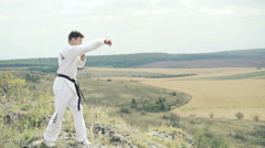 Young sportsman exercising on the rock Stock Footage