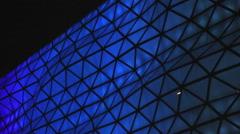 LED illumination on big shopping mall, blue lighting on building, Christmas mood Stock Footage
