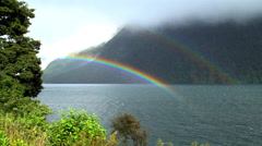 Landscape Photography of rainbow over Milford Sound Piopiotahi Fjord Fiordland Stock Footage