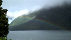 New Zealand landmark of Fiordland National Park with rainbow over water and Stock Footage