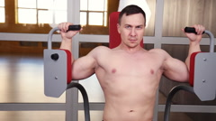 Butterfly Exercise Machine - Young Bodybuilder Doing Heavy Weight Exercise For Stock Footage