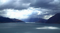 Cloudscape with reflection of sunlight on water of National Landmark Lake Wanaka Stock Footage