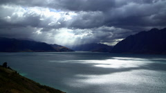 Remote environment of Lake Wanaka with reflection of sunlight on water through Stock Footage