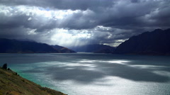 Cloudscape photography and sunlight over water of scenic holiday destination Stock Footage