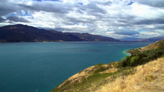 Natural beauty of turquoise color water on Lake Tekapo Mackenzie Basin South Stock Footage