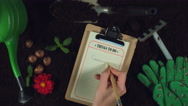 4k Gardening Composition of Hand Writing in Things to do list Stock Footage
