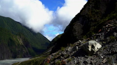 New Zealand extreme terrain of rock and mountain range on river valley Westland Stock Footage