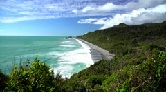 Waves from Tasman Sea on remote beach and uncultivated coastline of Paparoa Stock Footage