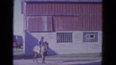 1965: young woman rides gray horse with young man who rides brown horse WAUPACA Stock Footage