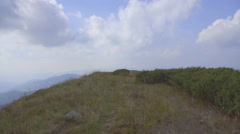 The walk in the mountain against the background of the fog. Real time capture Stock Footage