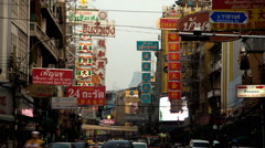 Traffic on Yaowaraj road, Bangkok's Chinatown, Thailand Stock Footage