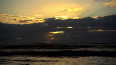 Seascape of sunset over Tasman Sea shoreline remote holiday destination Westland Stock Footage