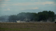 Arid rural environment of New Zealand farmland creating dust trail behind Stock Footage