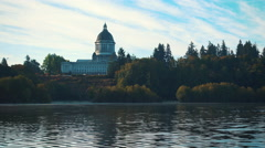 Bird Flys By Washington State Capitol Lake Stock Footage
