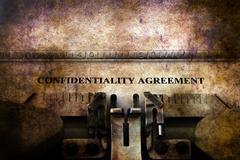 Confidential agreement on typewriter Stock Illustration