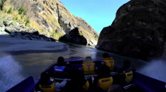 Exhilarating jet boat adventure at speed through Shotover River canyon Stock Footage