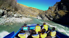 Thrilling adventure ride at speed through canyon on Jet Boat Shotover River Stock Footage