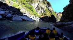 Outdoor tourist activity of exhilarating jet boat adventure through Shotover Stock Footage