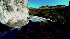 People enjoying danger and excitement on thrilling Jet Boat ride Shotover River Stock Footage
