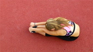 Top view of teenager girl athlete stretching before running on stadium Stock Footage
