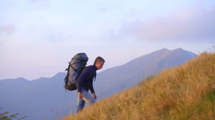 The climber walk to the top of the mountain. Real time capture. Wide angle Stock Footage