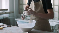 Girl watering dishes glaze in her studio Stock Footage