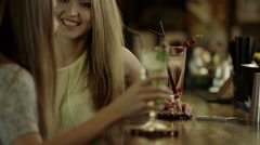 Women clinking glasses and enjoying cocktails Stock Footage