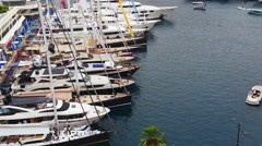 Luxurious Yachts Are Lined Up In The Monte-Carlo Harbour in Monaco Stock Footage