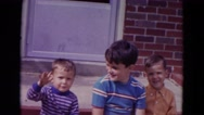 1967: brothers waving at camera on the patio. LINCOLN, NEBRASKA Stock Footage