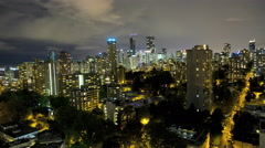 Time lapse Skyline night view of illuminated roads and buildings City apartment Stock Footage