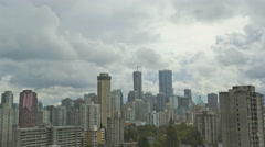 Time lapse Cloudscape Skyline daylight view of City buildings apartments and Stock Footage