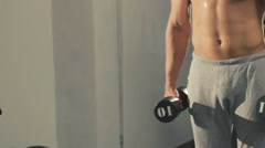 Young bodybuilder training with the loads for arms muscles in gym. Slowly Stock Footage