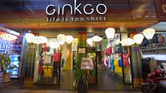 Ginkgo store selling tshirts in Ho Chi Minh City, Vietnam Stock Footage