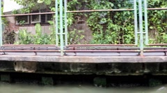 Shore of water canal. Sailing through the canal in city Bangkok, Thailand Stock Footage