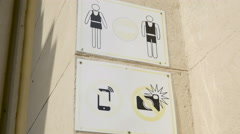 Prohibiting warning signs near enter. No short dress, no flash Stock Footage