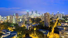 Time lapse illuminated night Skyline view of City traffic buildings apartments Stock Footage