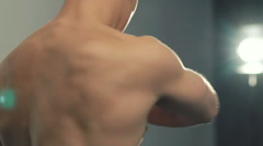 Close up of handsome sportsman kneads body in the gym. Slow motion Stock Footage
