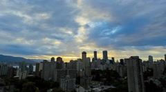 Time lapse sunrise Skyline view of City buildings apartments and Skyscrapers in Stock Footage