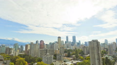 Time lapse Skyline Cloudscape sunlight view of City buildings apartments and Stock Footage